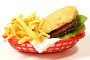 hamburger and fries in a basket